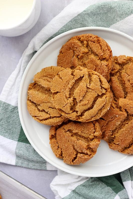 Gingersnaps layered on a white plate
