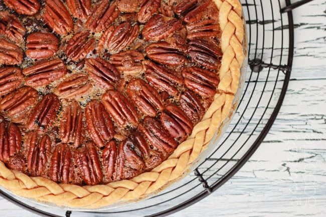 Top down image of pecan pie with pecans layered around the top