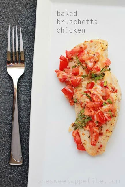 Baked bruschetta chicken on a white plate with a fork