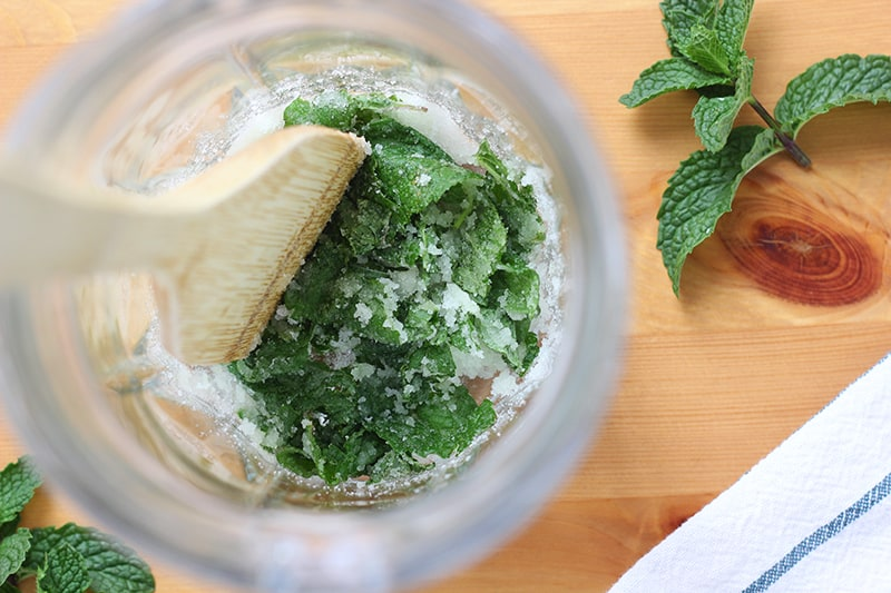 muddled mint in a large pitcher
