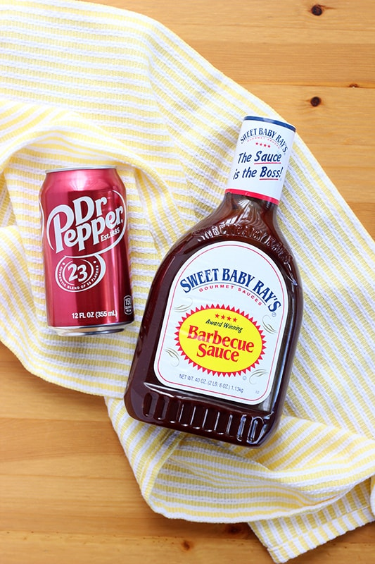 Can of Dr. Pepper soda and Barbecue sauce on yellow napkin
