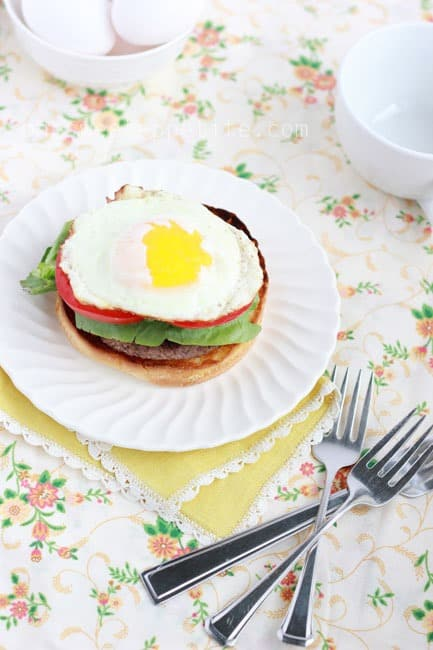 breakfast burger topped with a soft egg