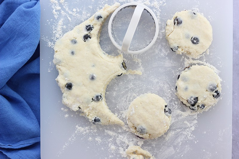 blueberry biscuit dough cut with cookie cutter