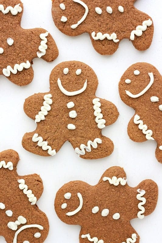 gingerbread cookies cut into men shapes with white icing