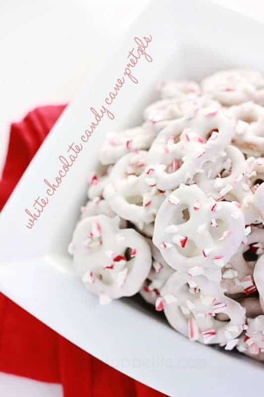 Pretzels covered in white chocolate and broken candy cane pieces