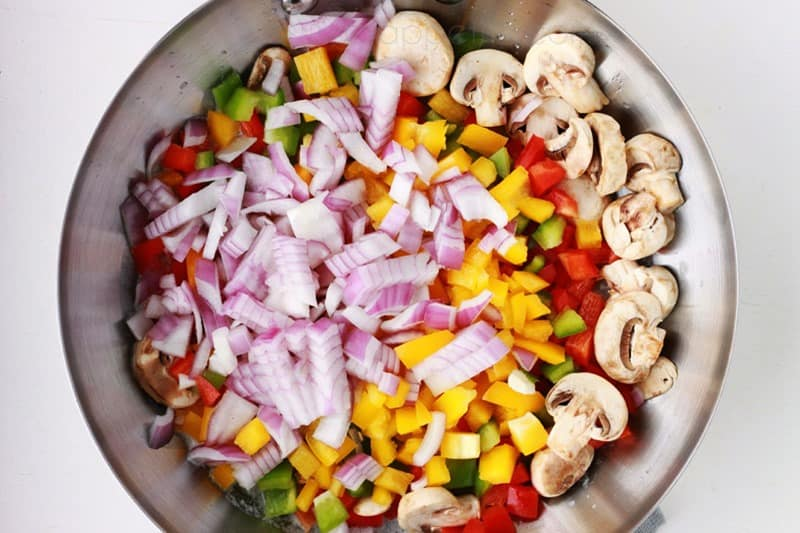 pan of diced vegetables for cajun pasta