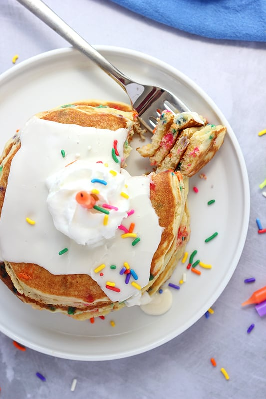 Easy Birthday Pancakes on a white plate with sprinkles