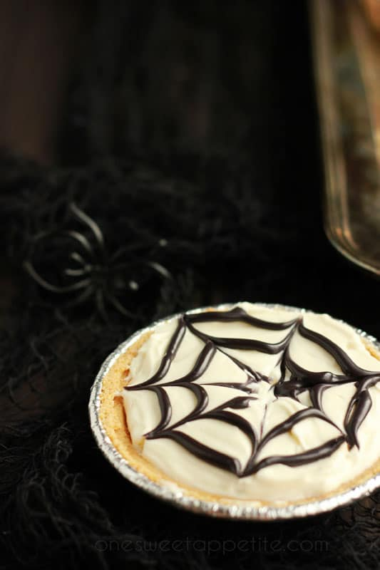 No Bake Spiderweb Cheesecakes on One Sweet Appetite