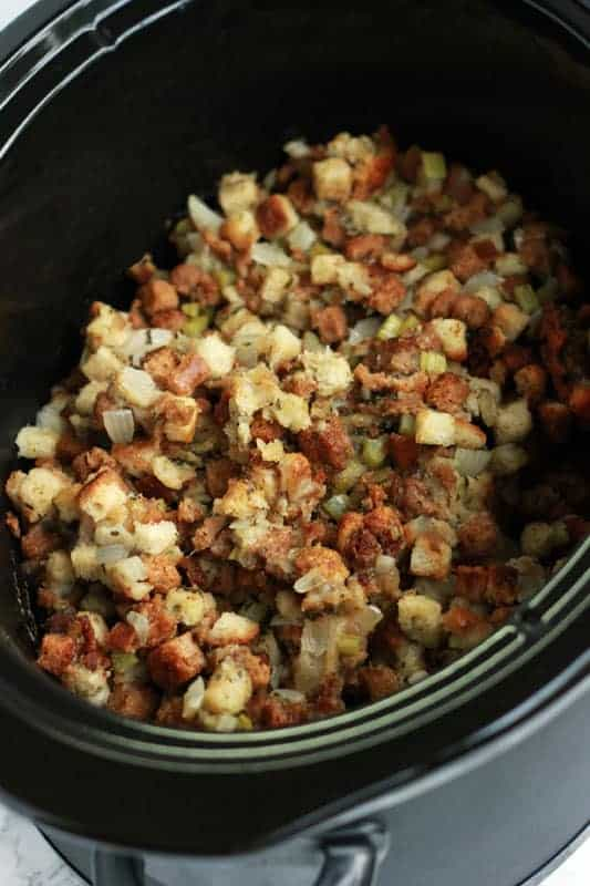Slow cooker filled with cooked stuffing