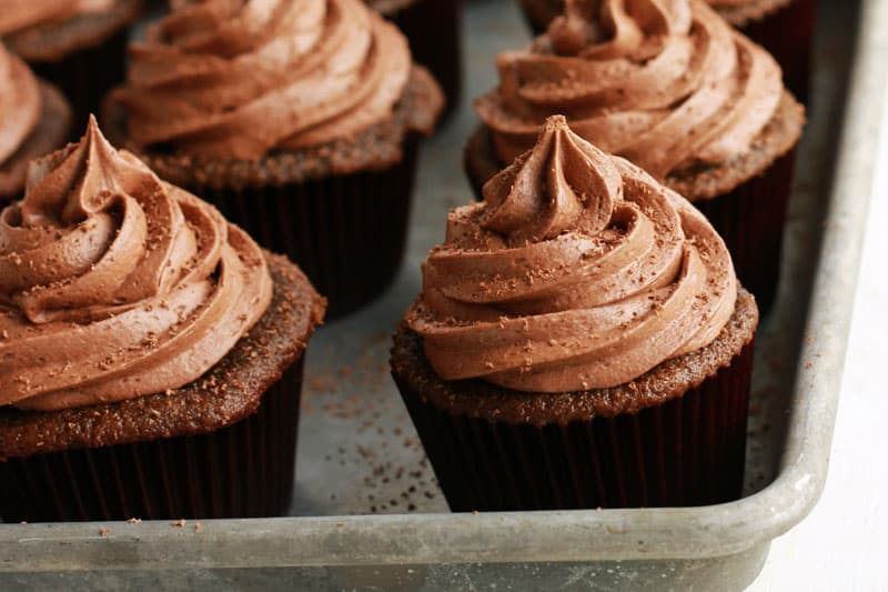 chocolate cupcakes lined on a baking tray