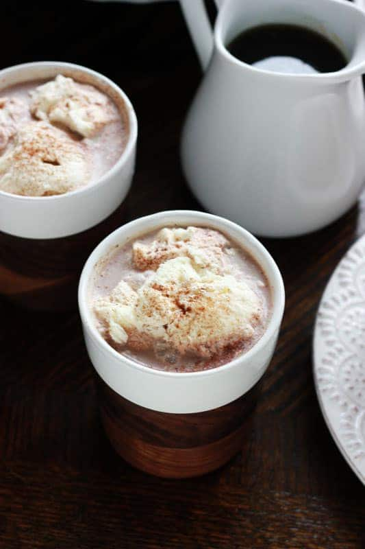 two cups of hot chocolate topped with whipped cream