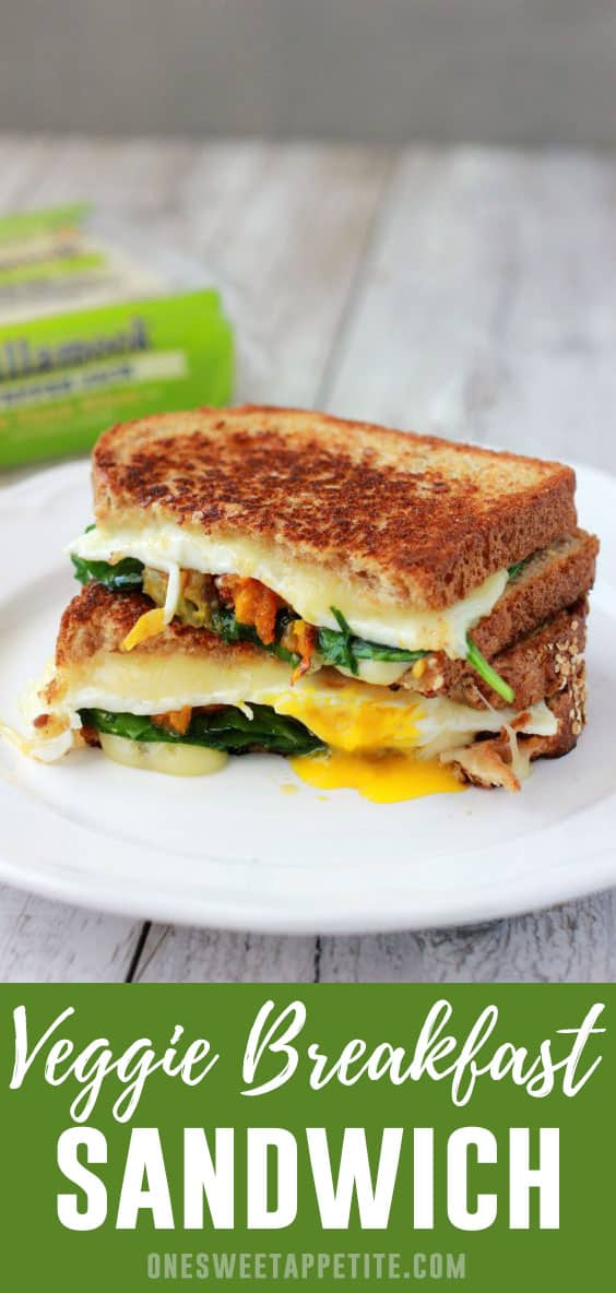 This gourmet breakfast sandwich recipe is a real treat. A soft fried egg is topped with pepper jack cheese, roasted tomatoes, and spinach for a filling and easy breakfast recipe.
