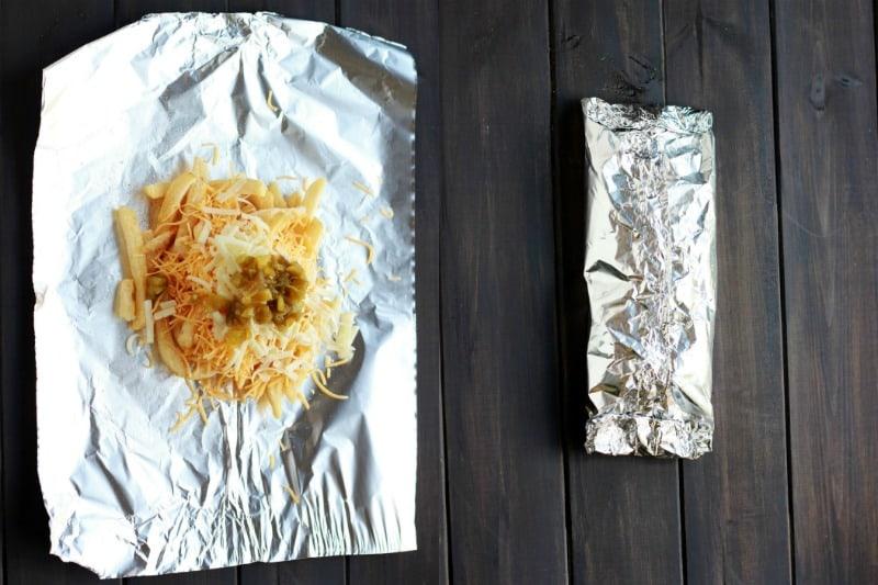 folding a tin foil dinner