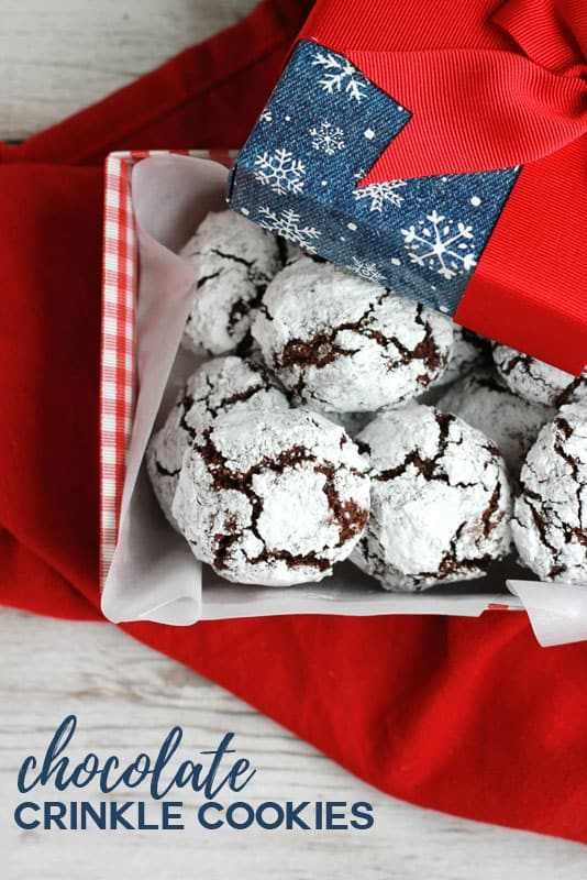 Chocolate Crinkle Cookies stacked in a holiday box