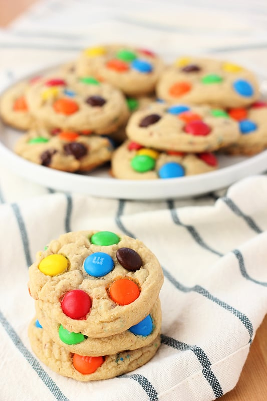 M&M Cookie Recipe stacked on table