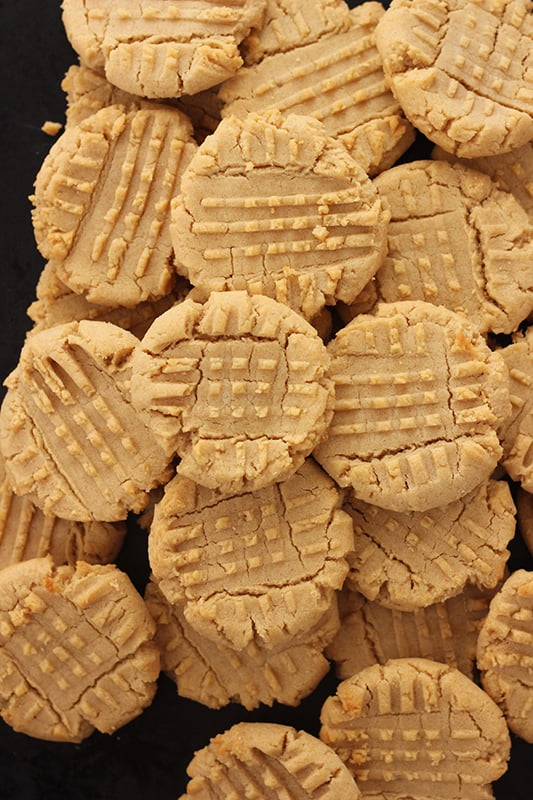peanut butter cookies stacked on black tray