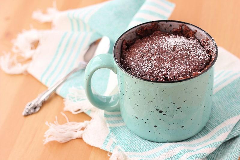 Nutella Mug Cake Recipe on a table in a light blue mug