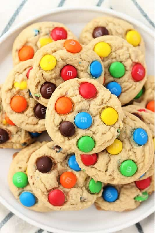 Stack of M&M Cookies on a white plate