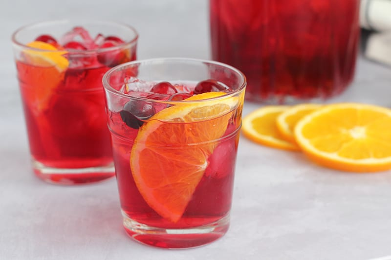 two glasses of punch with orange slices