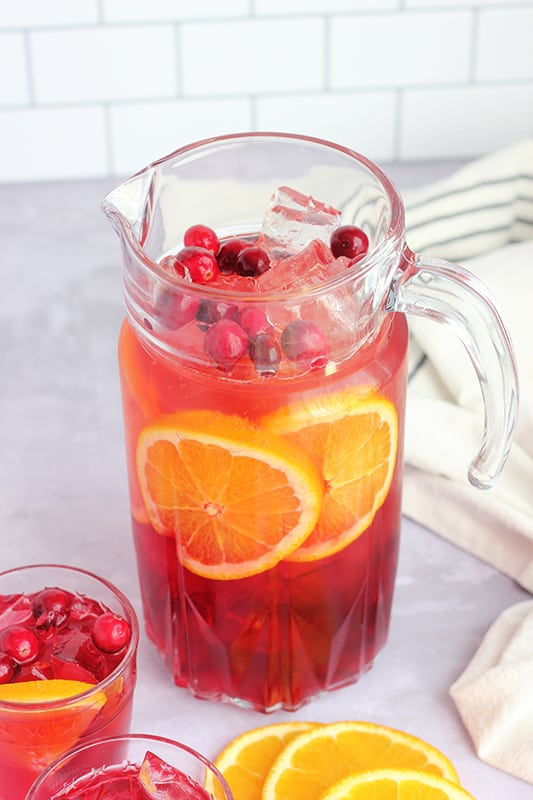 punch in a large pitcher with sliced oranges