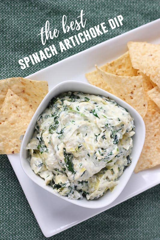Spinach Artichoke Dip in a white bowl with tortilla chips