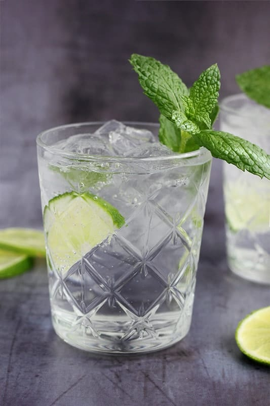 Tequila Mojito recipe with sliced lime and fresh mint