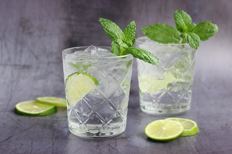 Tequila Mojitos with sliced lime and fresh mint