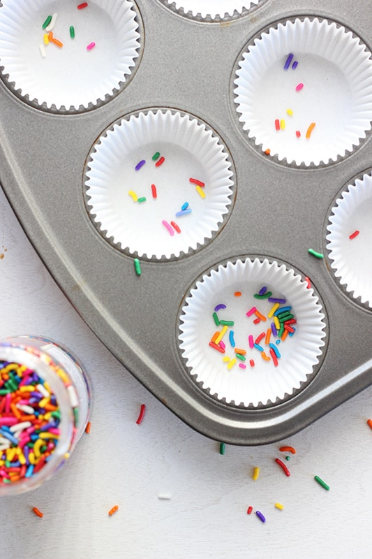 Sprinkles in white cupcake liners