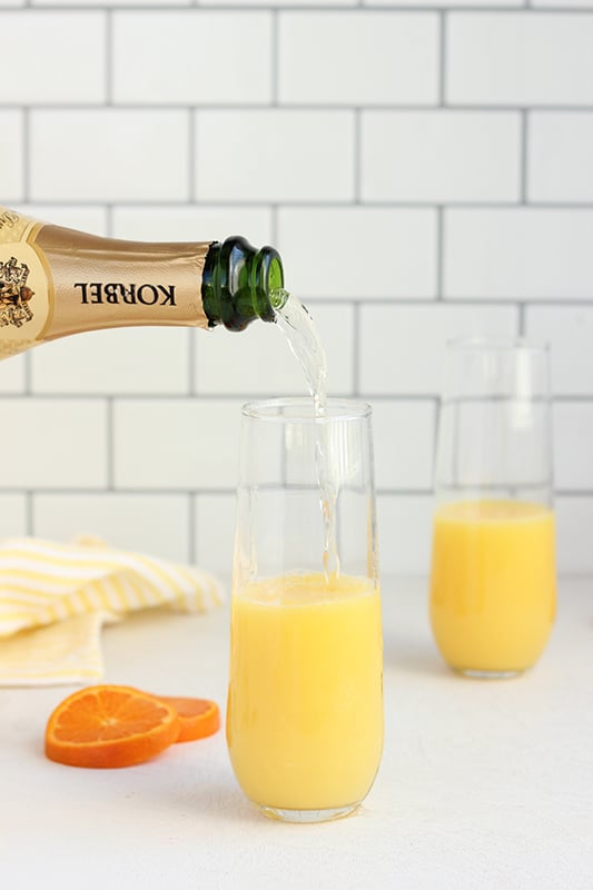 champagne pouring into orange juice