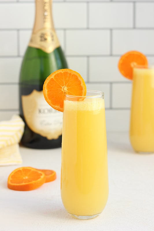 Mimosa in tall glass with orange slice