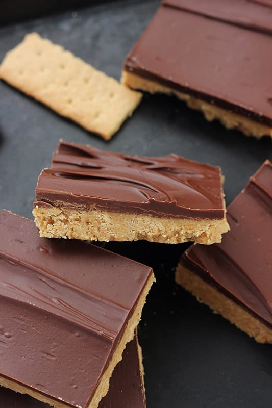 chocolate peanut butter bars layered on tray