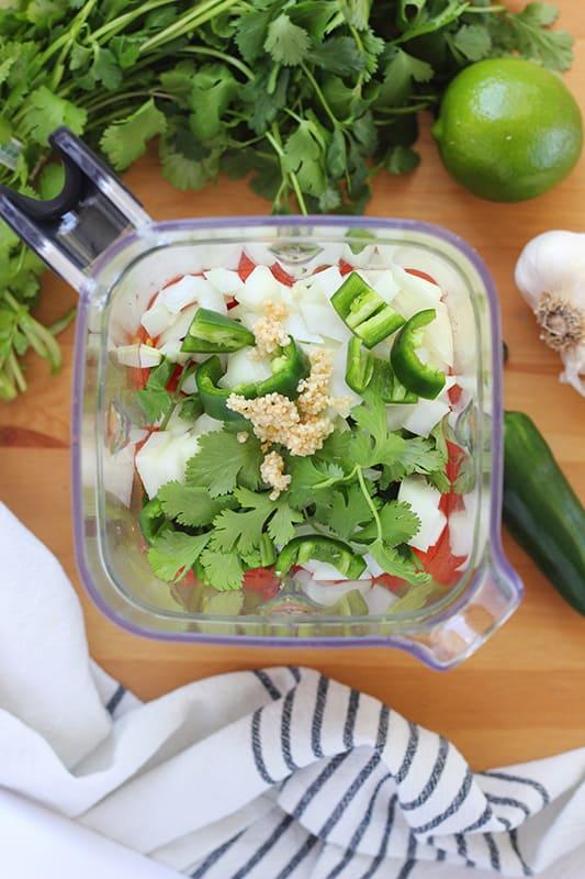 ingredients for salsa in a blender