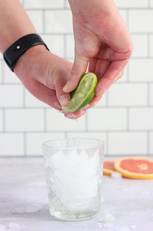 lime squeezed into glass
