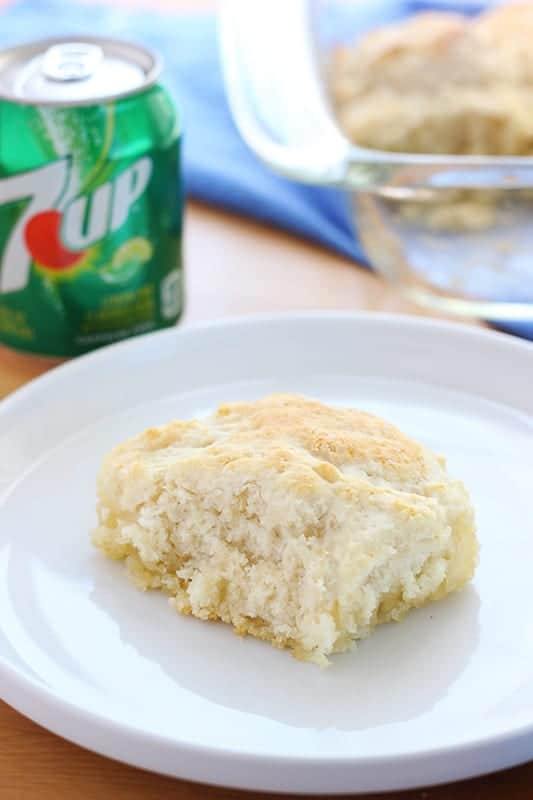 Fluffy biscuit on white plate with soda can