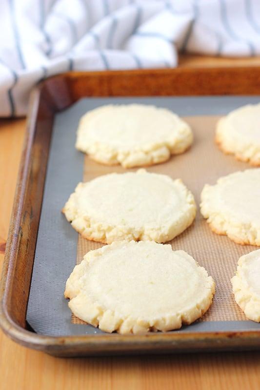 sugar cookies cooling on a pan