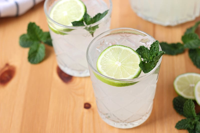 Two glasses of limeade with fresh lime slices and mint