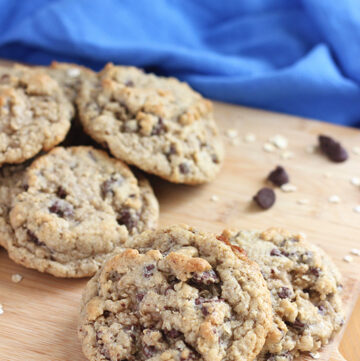 oatmeal chocolate chip cookies on cutting board with blue napkin