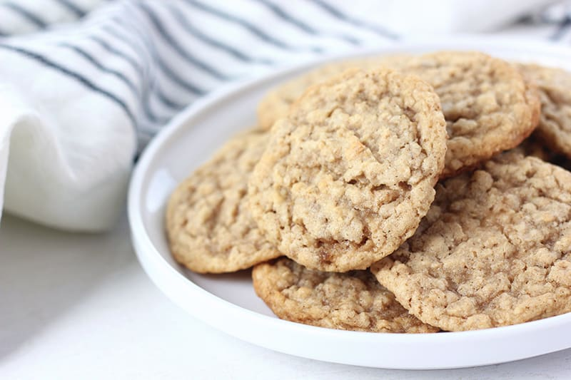 Oatmeal cookies on a white plate with a napkin