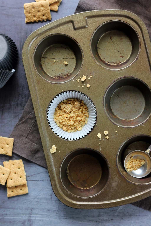 graham cracker crumbs in cupcake liner