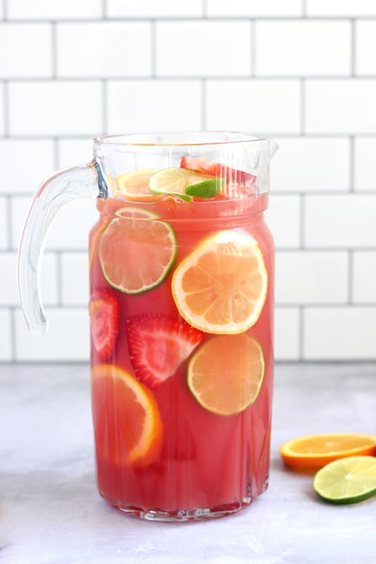 Pitcher of punch with sliced fruit