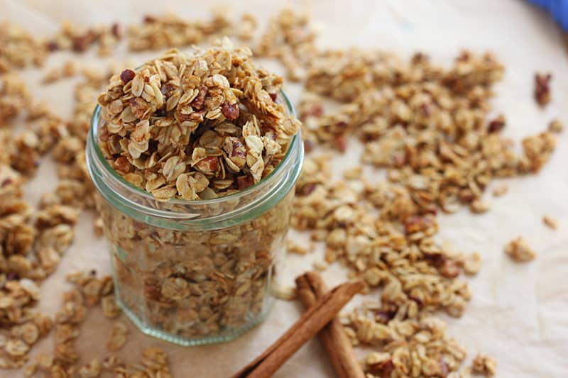 cinnamon granola in a mason jar spilling over the sides