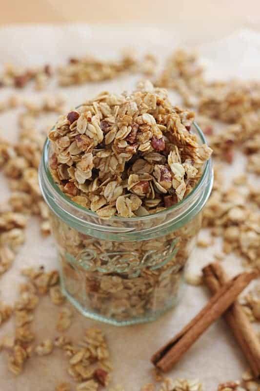 cinnamon crunch granola spilling over the side of a mason jar