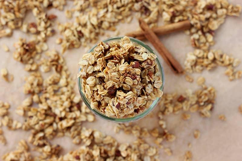 jar of granola with cinnamon sticks