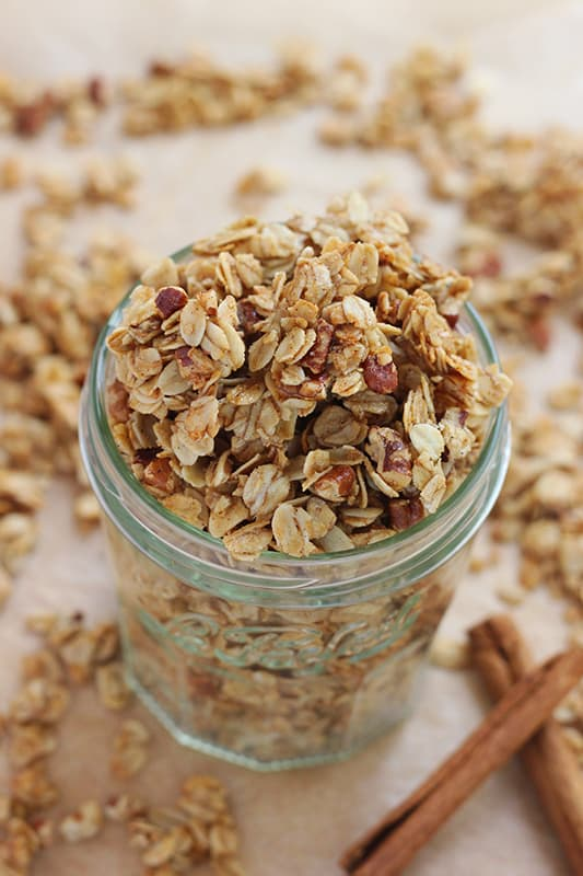 Jar of granola with cinnamon and pecans