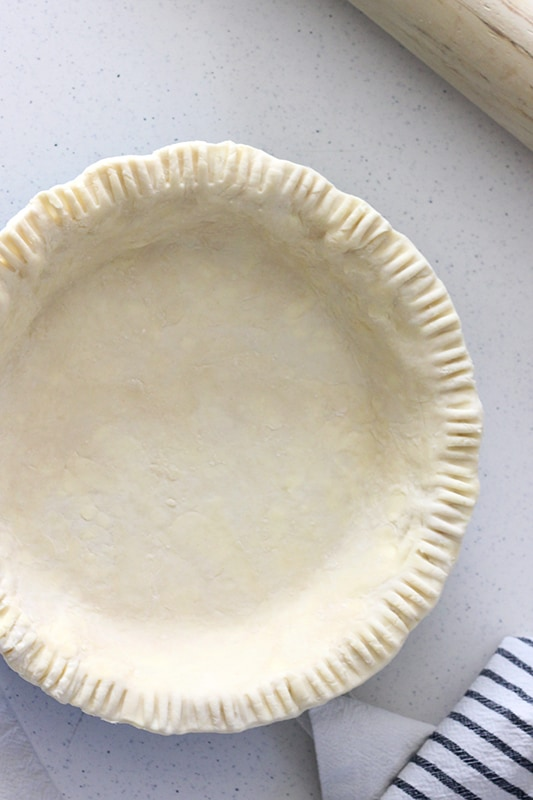 Unbaked Pie Crust in pie plate on counter