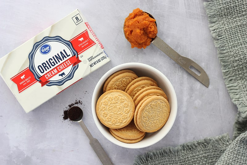 Ingredients; cream cheese, instant espresso, pumpkin, and Oreo cookies on counter