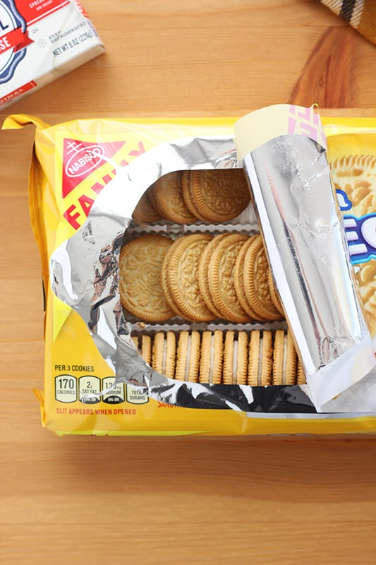 bag of golden oreo cookies on a wood table