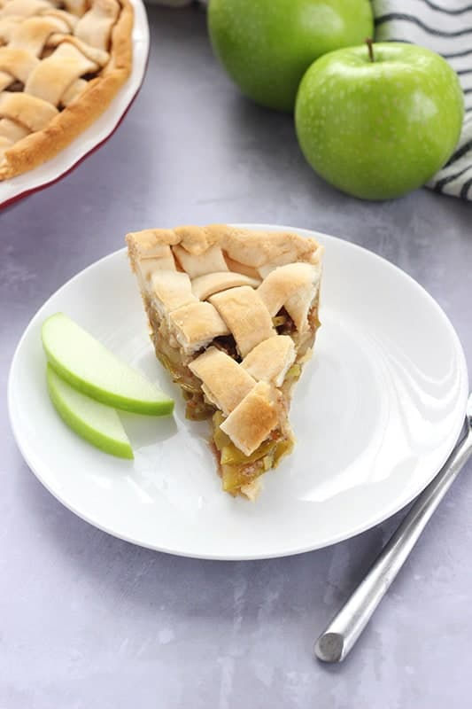 slice of apple pie on white plate