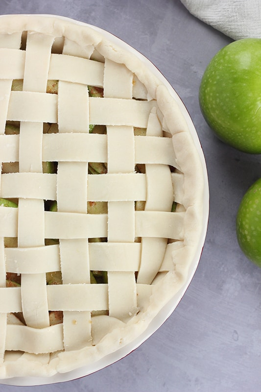 unbaked apple pie with lattice crust on counter