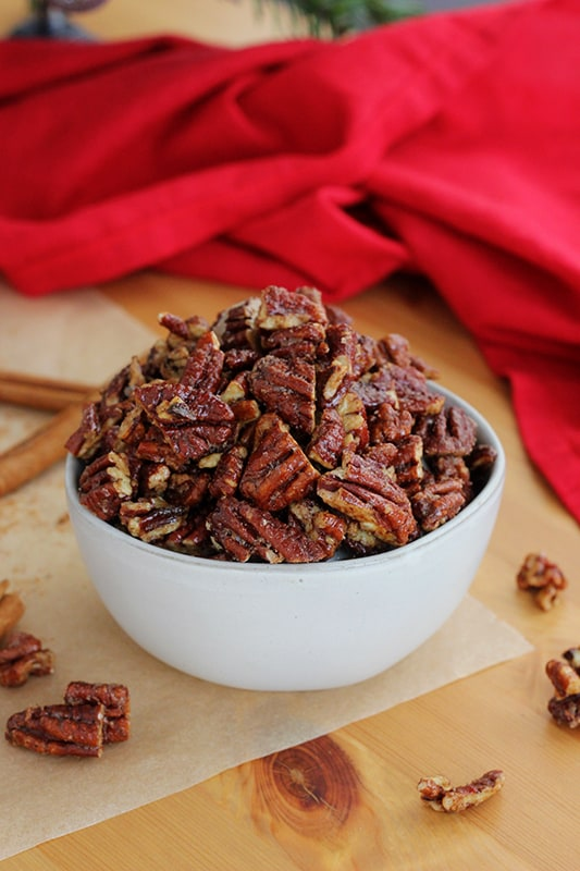 homemade candied pecans in a white bowl